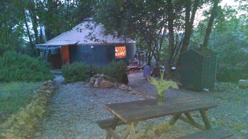 The yurt is located on five peaceful acres equidistant from the three forks of the Yuba River.