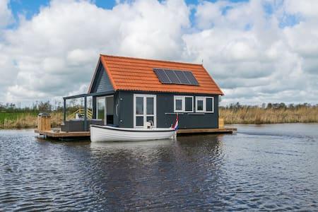 Luxe waterwoning met Sloep! - Sneek - 船