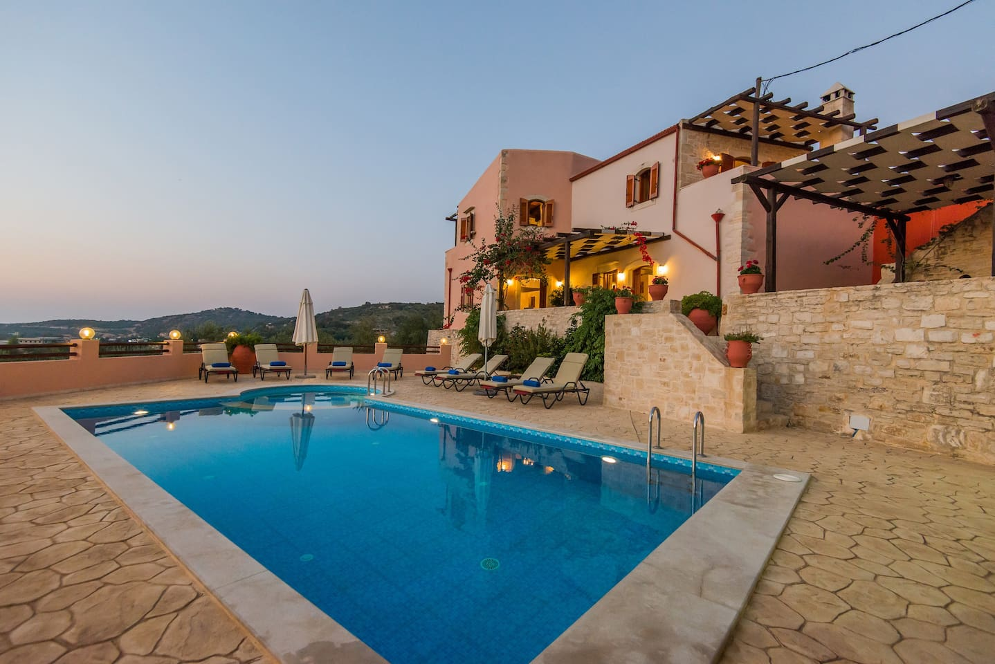 Villa Dafni has a private swimming pool and a stone paved terrace.