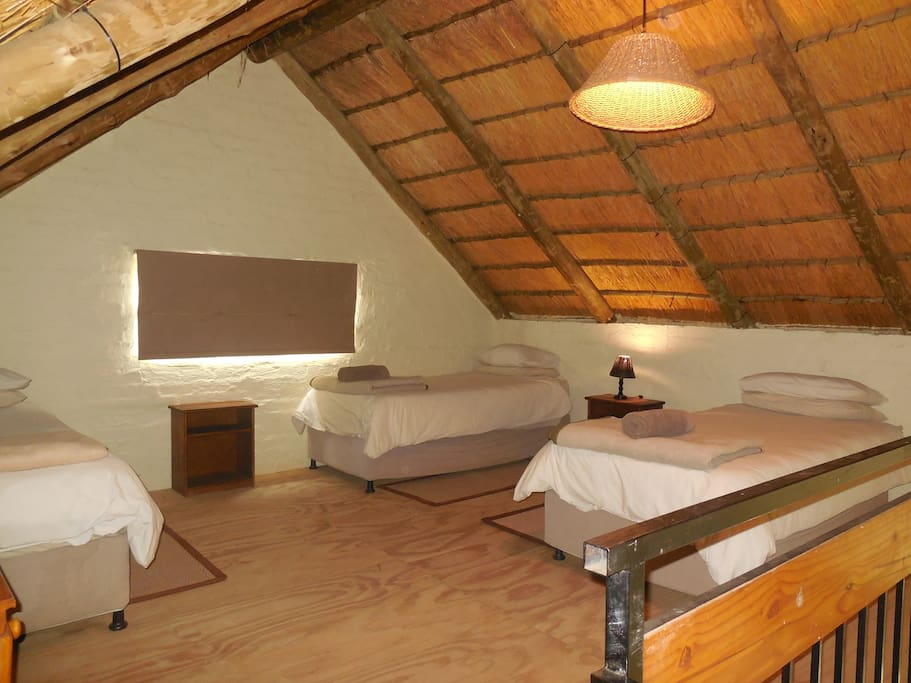 Loft bedroom with 3 single beds