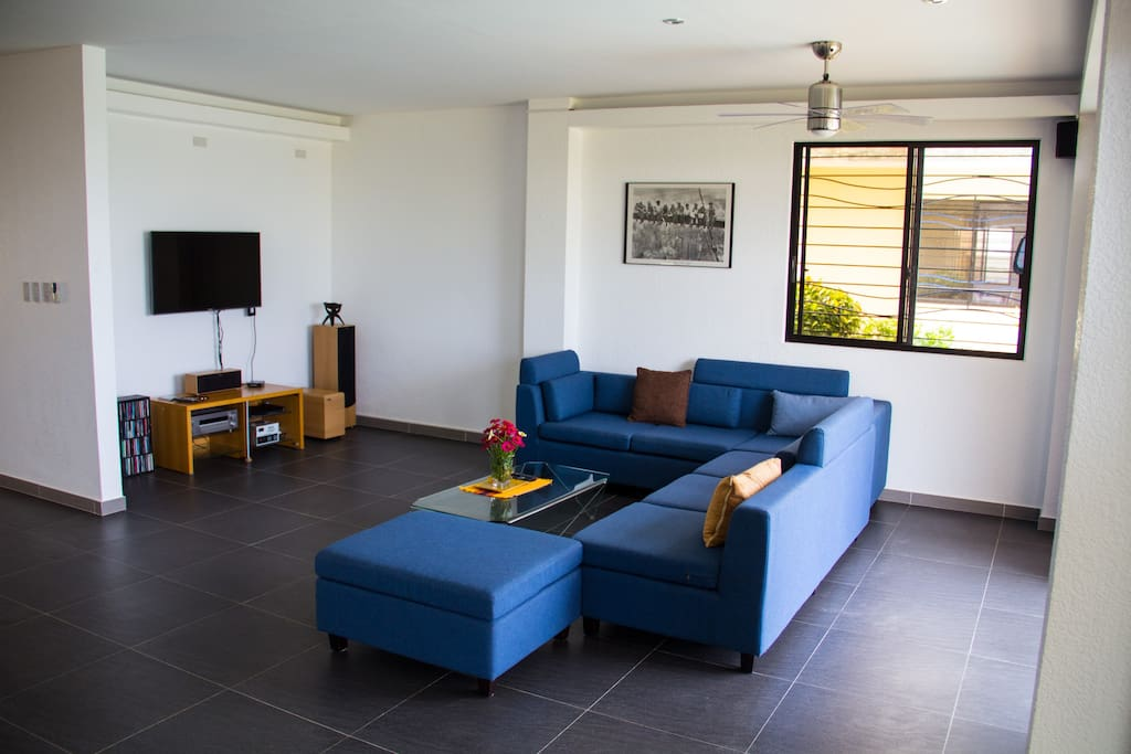 Bright, large living room with Satelite TV, DVD and surround system. The couch invites you to sleep at noon.