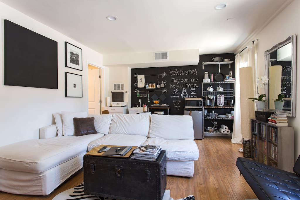 Living room: elegant, clean, modern design, East meets West, fully equipped entertainment center, can sleep 2 on the couch or use the provided air mattress