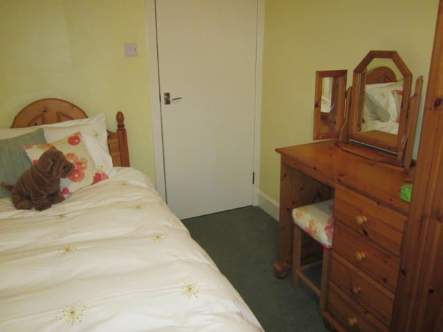 Dressing table and wardrobe in twin bedded room.