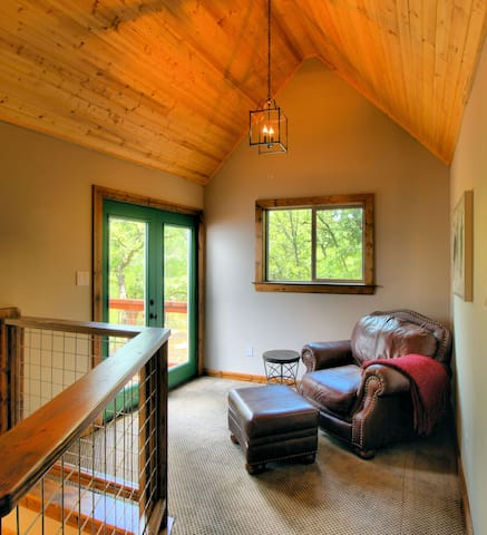 Grab a book and curl up in this nook upstairs.