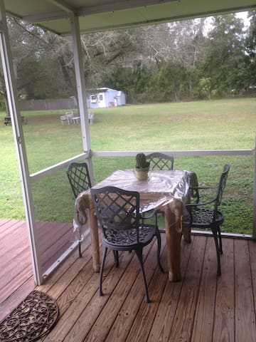 Table in screened in porch to eat at