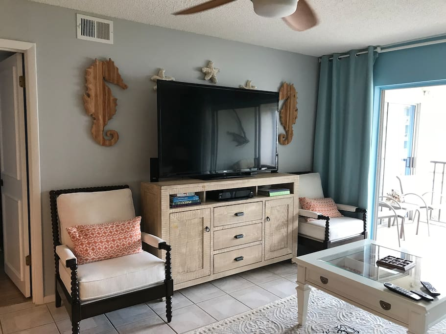 65' TV with tons of DVDs and wii and xbox game consoles