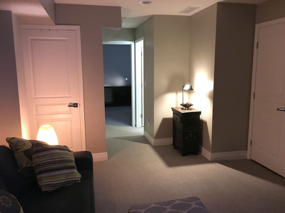 basement living area. large tv and sofa. - private