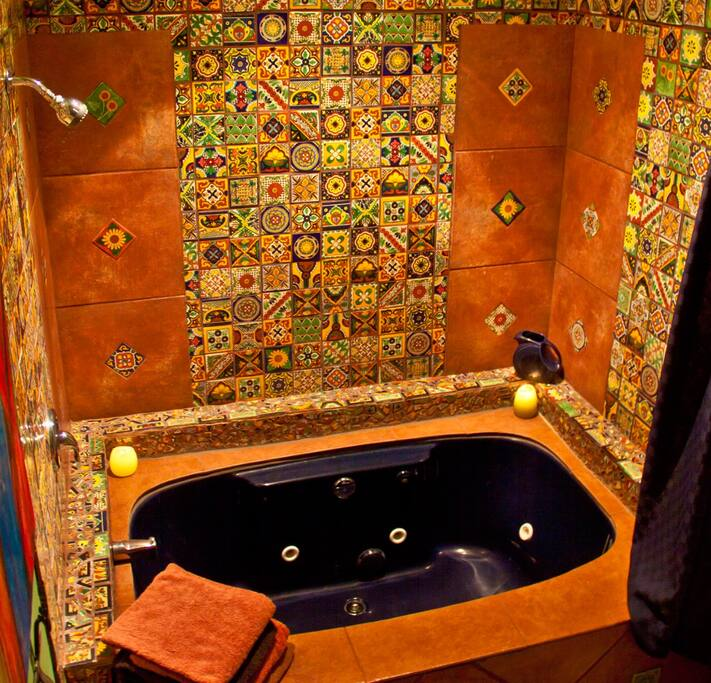 2-person jetted bathtub with mosaic tiles