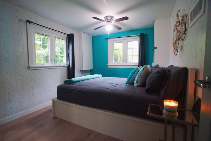 Bedroom 2 with Queen Size bed, ceiling fan and extra blanket.