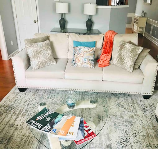 Large, comfortable, stylish sofa with room for 4. Looking for your next great travel destination? Enjoy a variety of travel magazines that will tease your imagination with great exotic travel destinations.