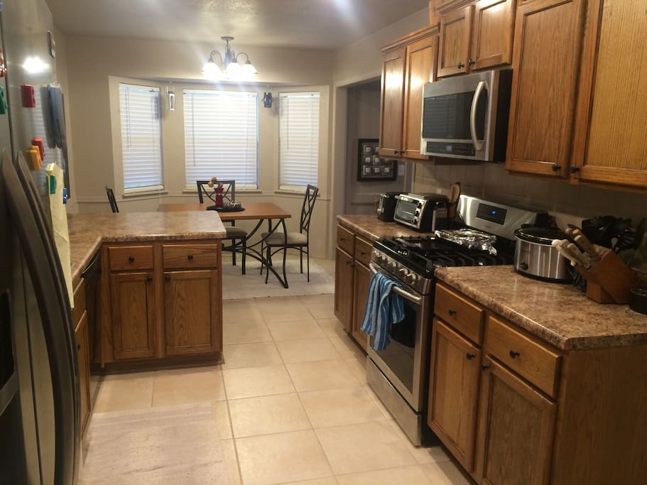 Fully functional kitchen with room in the fridge as well as a washer and dryer leading out to the garage