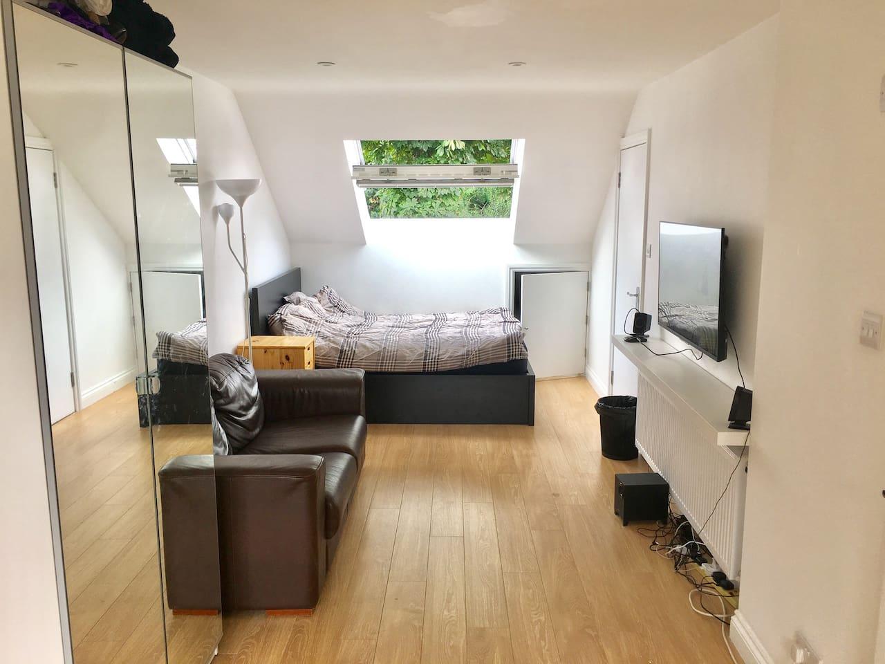 "the sleeping area: double bed, sofa 43"" TV, wardrobe"