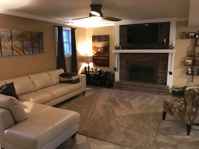 "Our entertainment area with wood burning fireplace, 46"" HD TV, Apple TV, Xbox One, PS4, Nintendo Switch, and DVD/Blu-ray player."