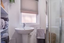 Brand new bathroom with walk-in shower.
