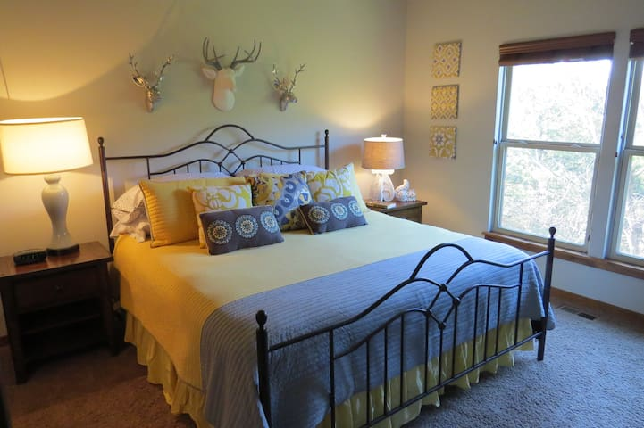 Master suite with king sized bed on main level