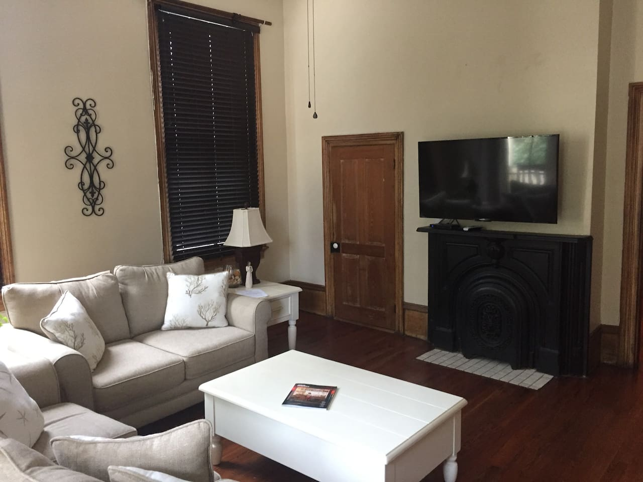 Spacious living room with large screen TV with Direct TV