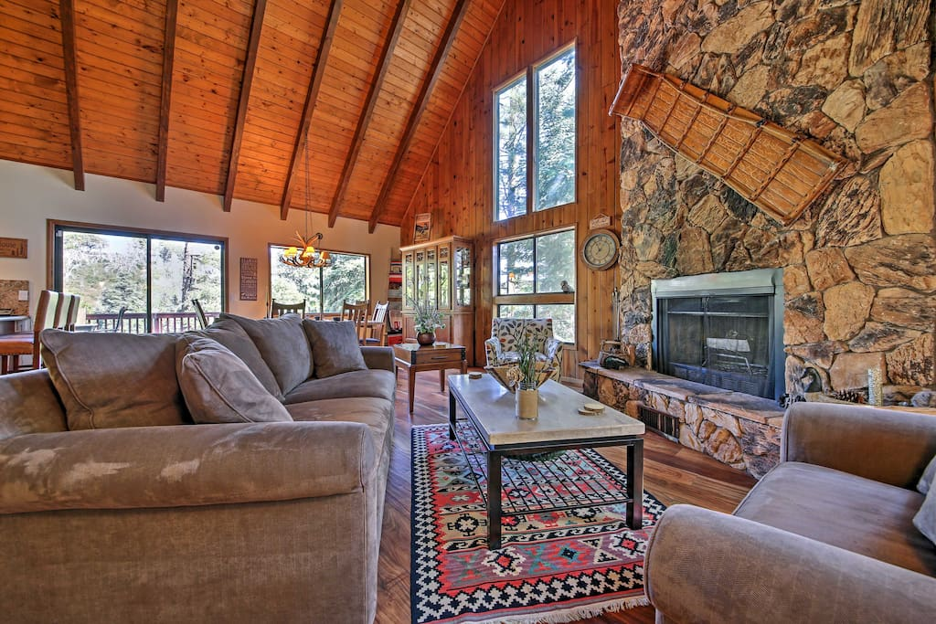 On chilly evenings, curl up on one of the couches in front of the rock wood-burning fireplace.