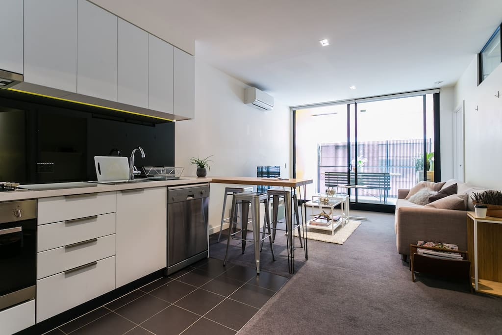 Open plan kitchen w dishwasher, microwave, gas oven/stovetop