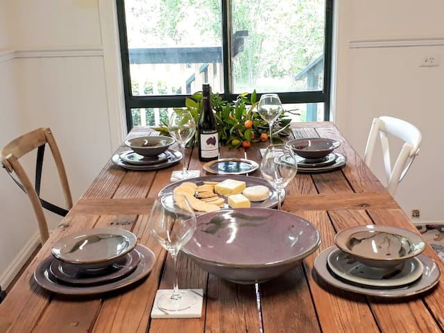 Gorgeous rustic oversized table  displayed with sandys hand made pottery, overlooking gardens and balcony