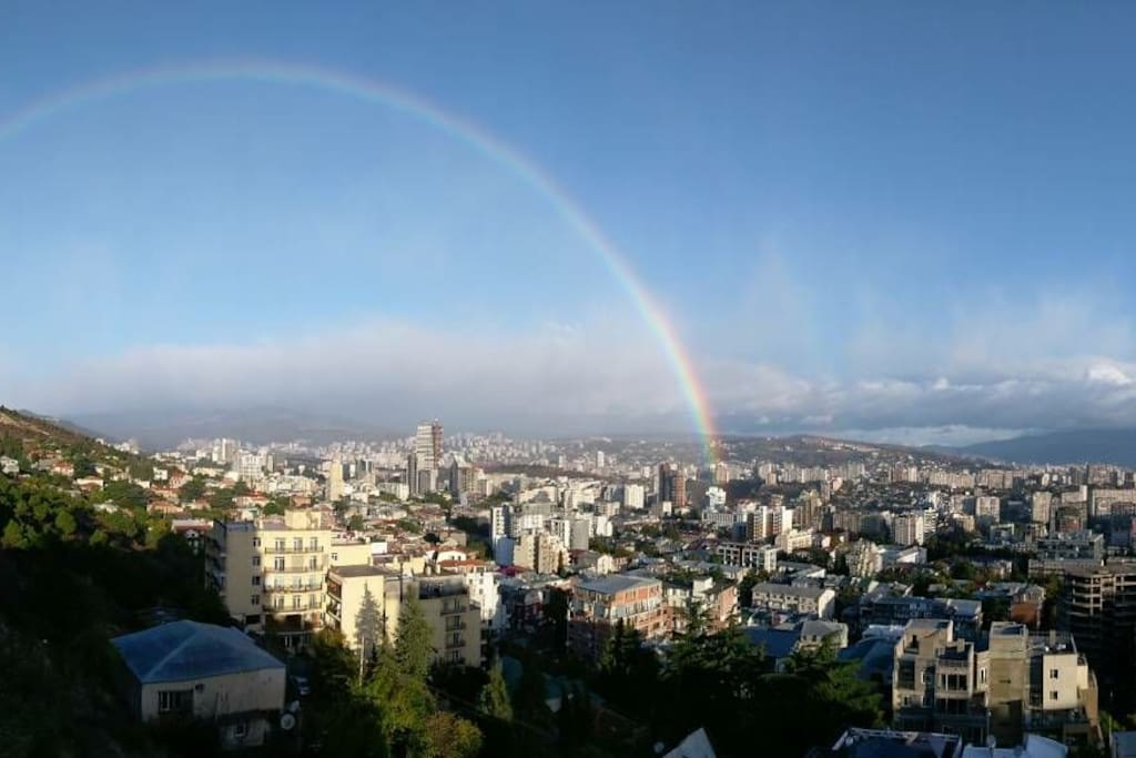 Watch double rainbow over the city!