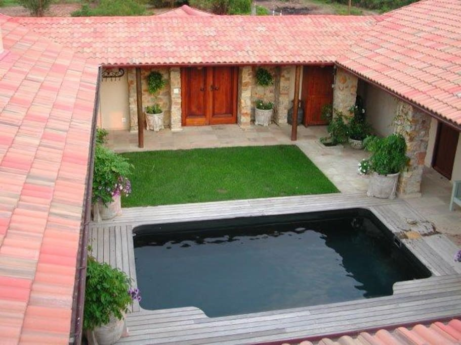 Upper terrace view of Courtyard with pool