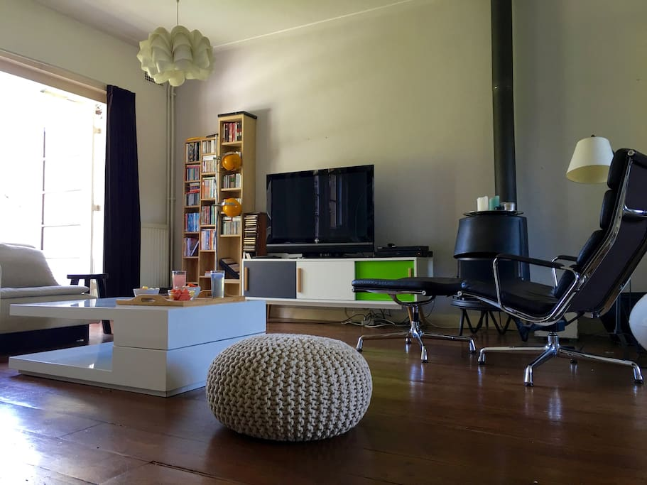 Large comfy couch, flatscreen with apple tv,  fireplace and Eames chair