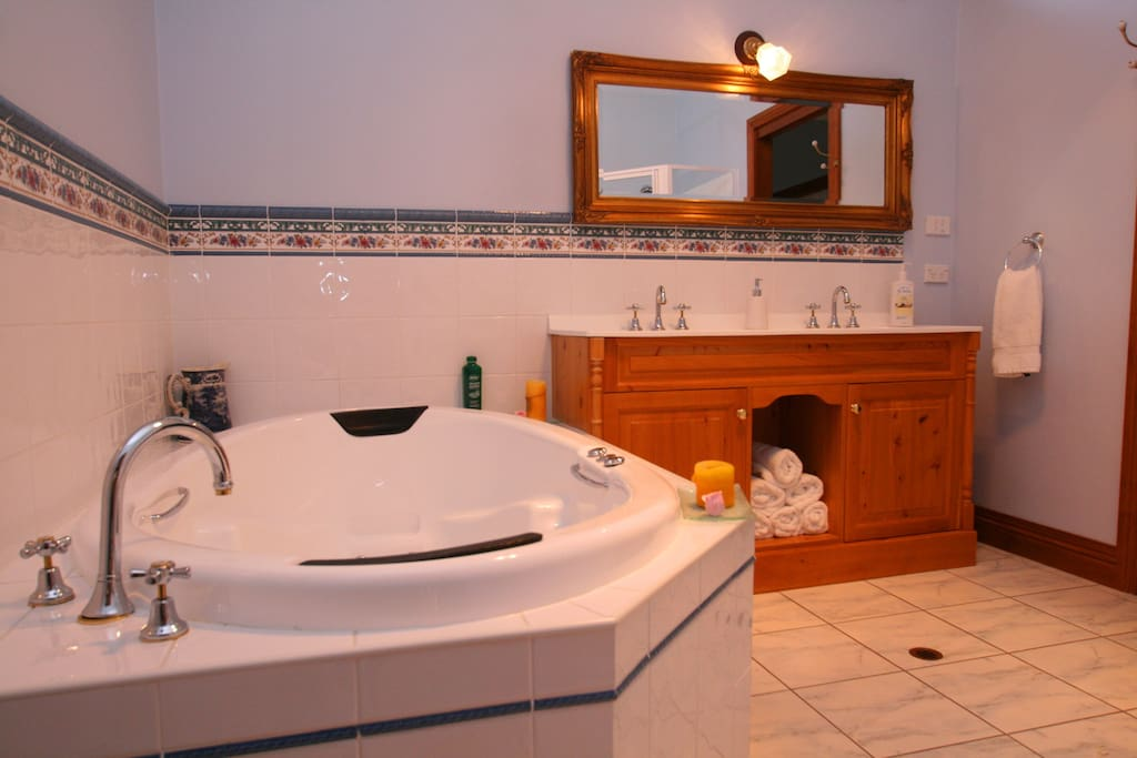 Spa bathroom with separate walk in shower