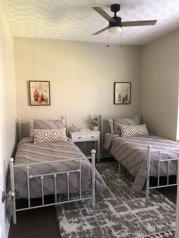Guest bedroom with 2 separate twin beds and full size closet for hanging clothes