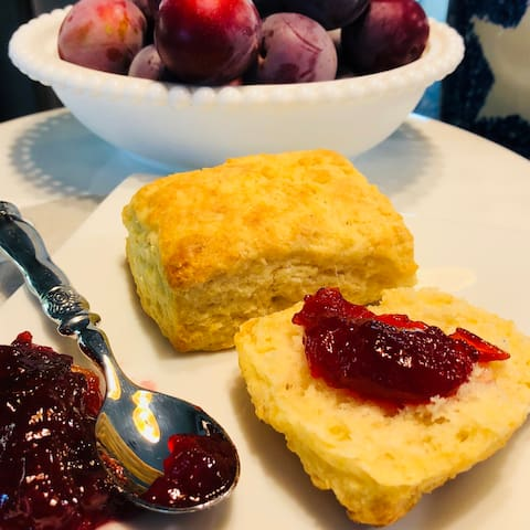 Fresh homemade biscuits with jam made from plums from our trees.