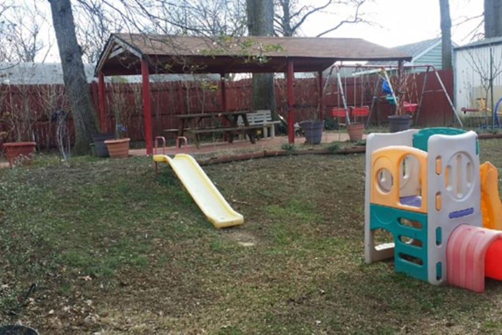 backyard; open space for young children to play  or to set up a BBQ