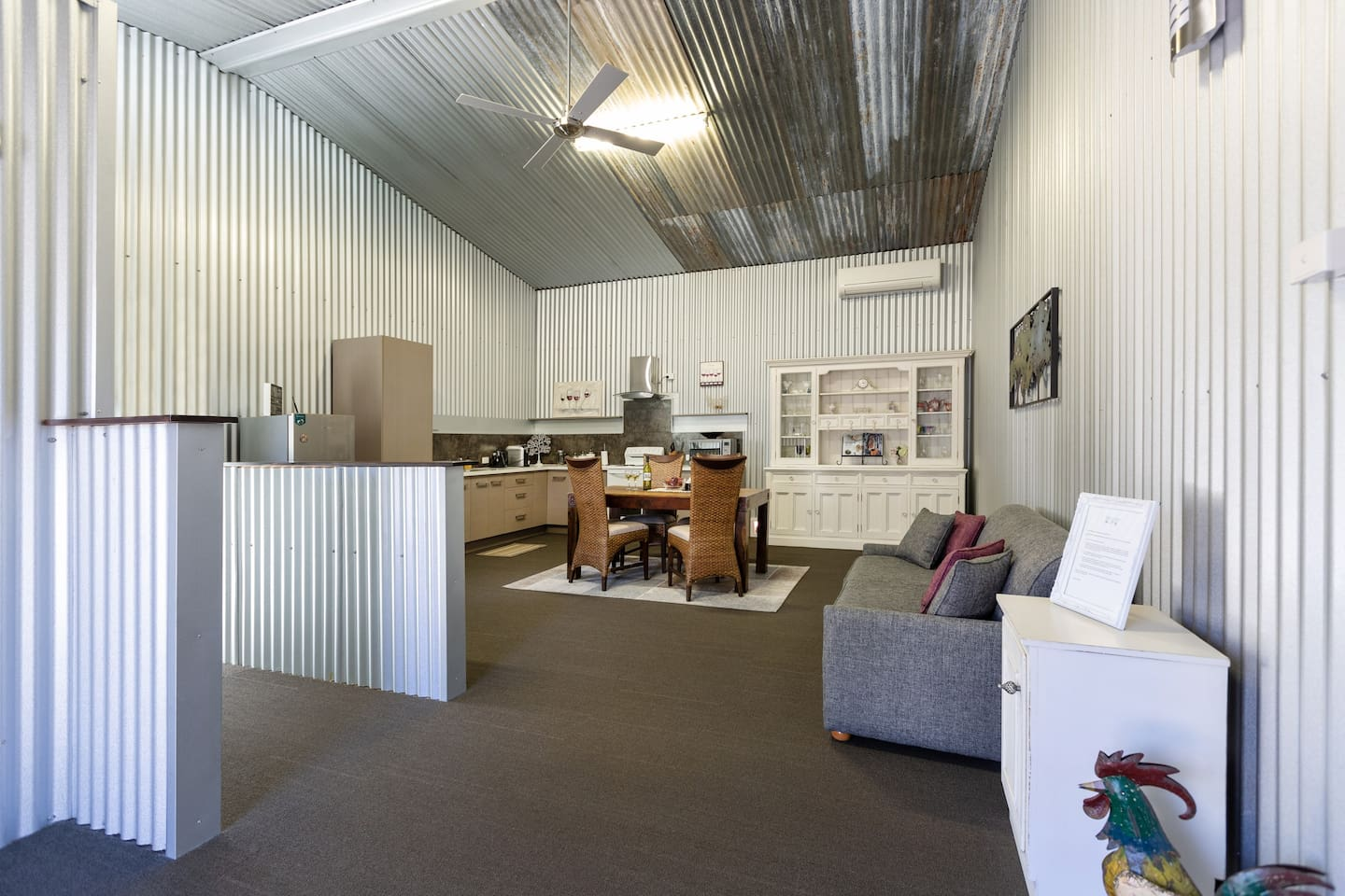 Very spacious kitchen/dining area in our renovated Barn located on 10 tranquil acres.  There's a sofa bed should you have an extra guest or two want to join you on your Hunter escape