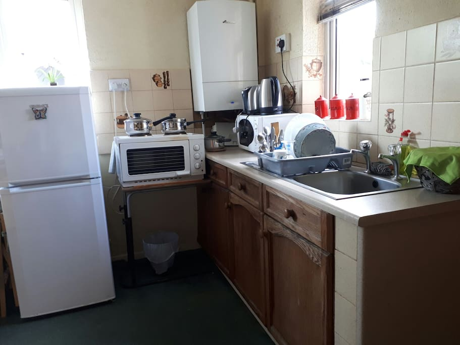 kitchen with oven and microwave
