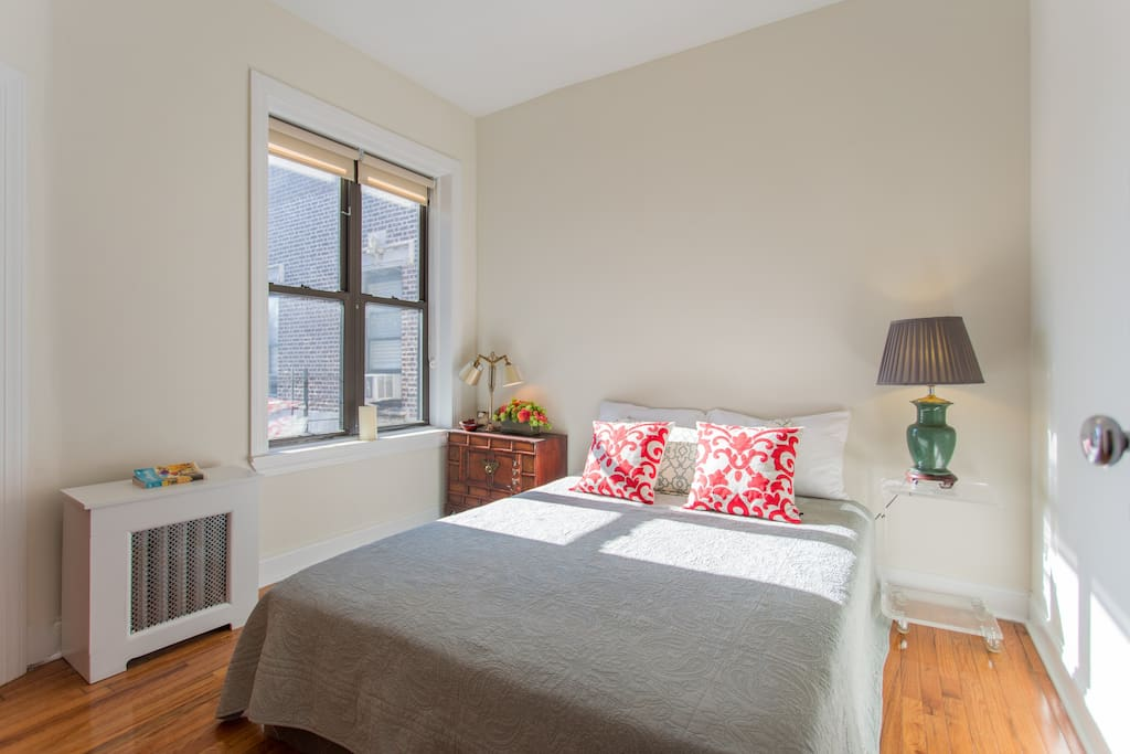 Your private bedroom with a private bathroom, views of Central Park, and plenty of light