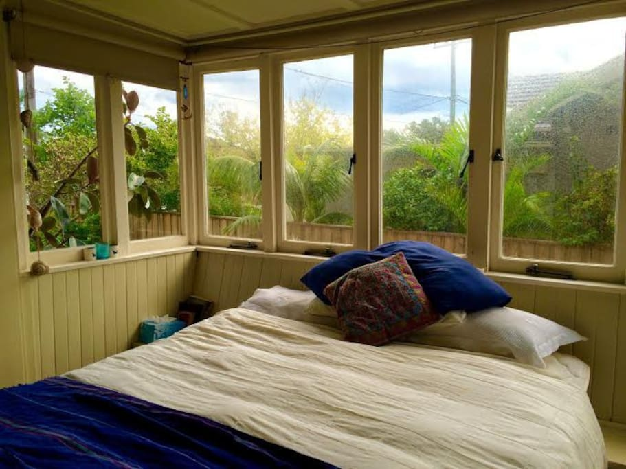 Bed in big bay window.