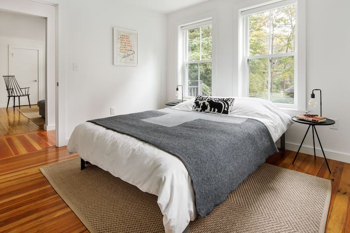 Second bedroom includes a queen size bed and a large closet with hanging and shelf storage