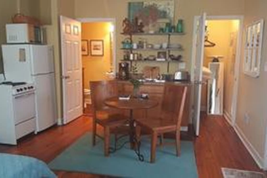 full kitchenette with stove, refrigerator, coffee maker, toaster, dishes, and more!