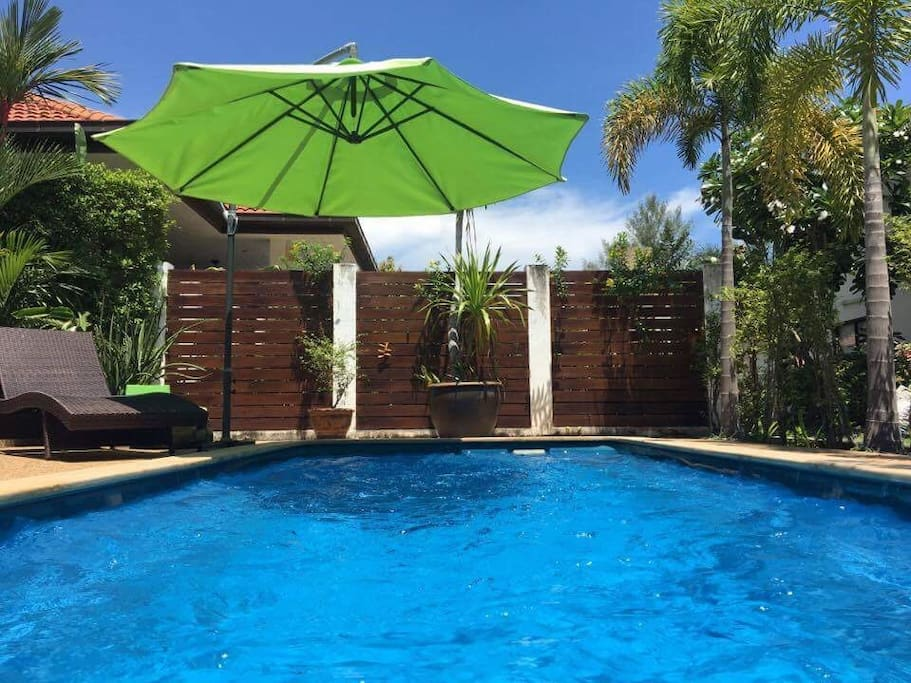 The pool is a beautiful oasis in front of the villa.