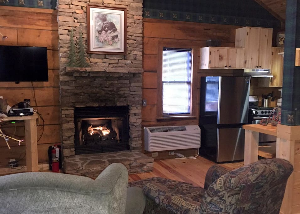 Comfy living area with gas fireplace, flat screen TV and two easy chairs