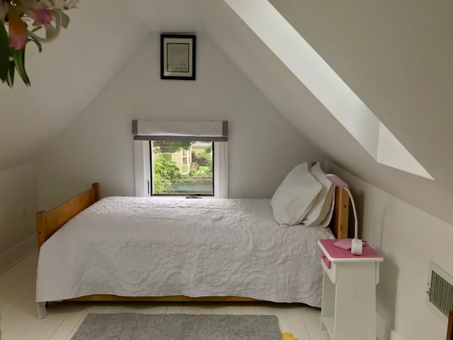 Second 3rd floor bedroom, extra long twin with natural rubber mattress and small trundle bed (suitable for small child only.)
