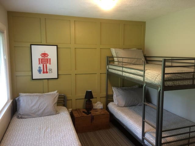 Second bedroom with three twin beds.
