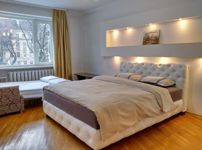 First Big Bedroom (Avenue Views): King bed and double pull-out sofa (prepared on request) with the best views of lively Svoboda Avenue.