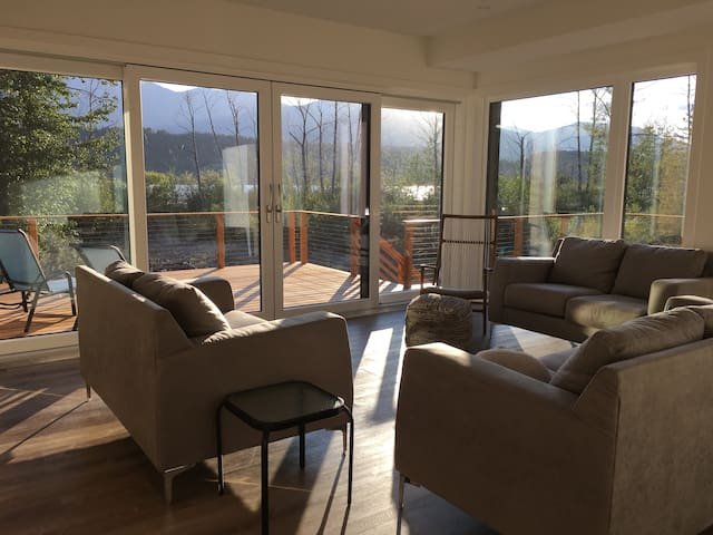 Main floor living room with a one of a kind, private view of the lake and mountains