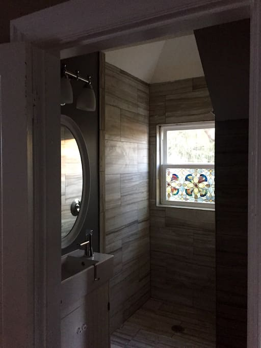Brand new bathroom with vaulted shower stall