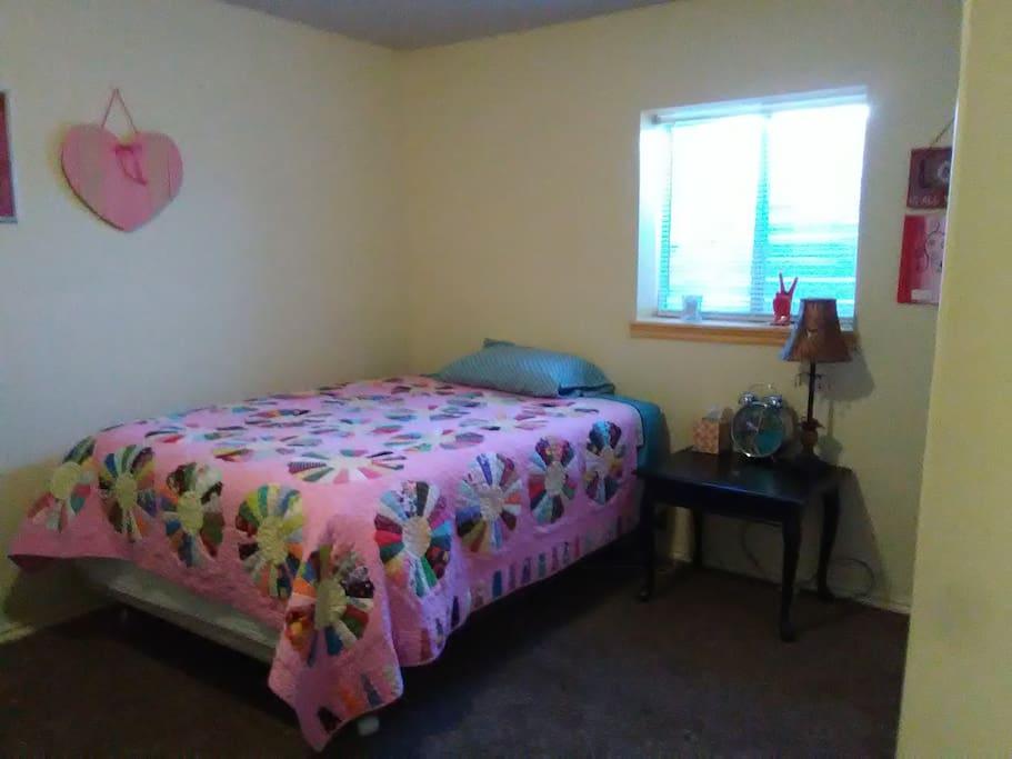 Large bedroom has double bed, sleeps two.
