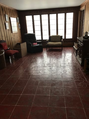 Florida Sun Room rose marble floor tile from Cuba. Home designed one of a kind by architect that sold Maine timber to Cuba and imported Cuban tile to USA . Blue & Red room suites tiles from Cuba.