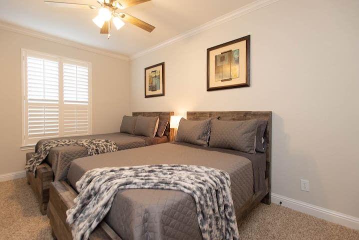 Bedroom #3:  2 Full Size Beds and a 65-inch Smart TV.   Hallway bathroom shared between Bedrooms #2 and #3.