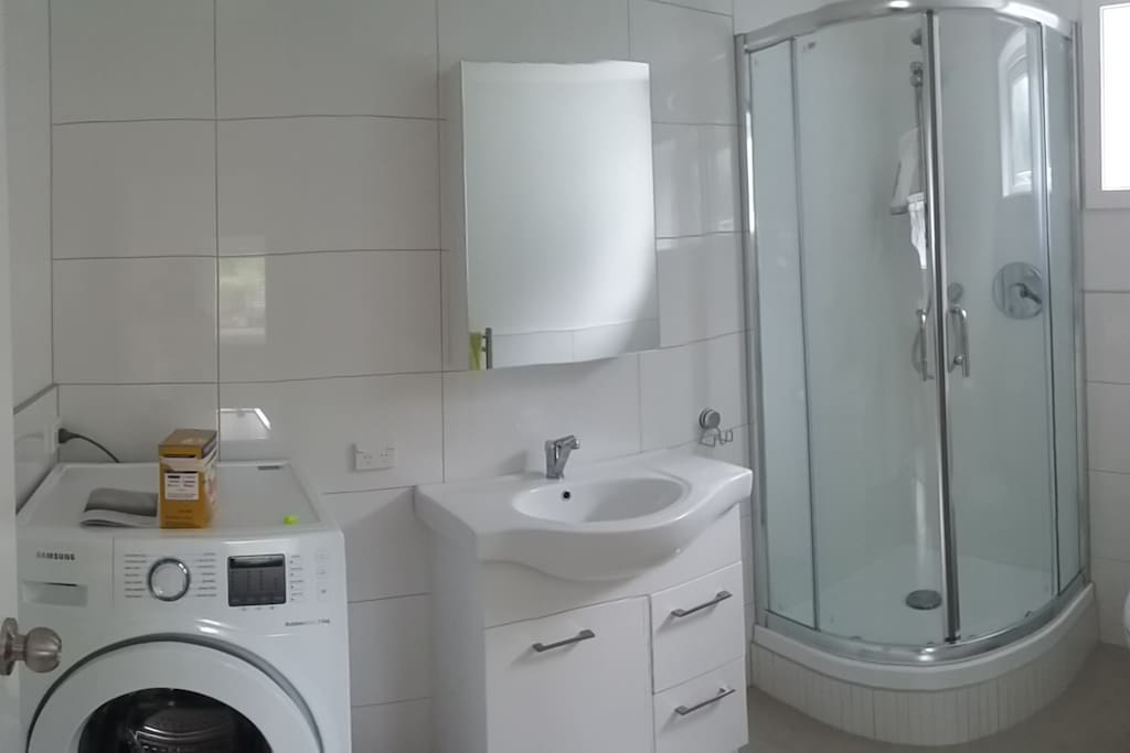Fully tiled bathroom with Laundry