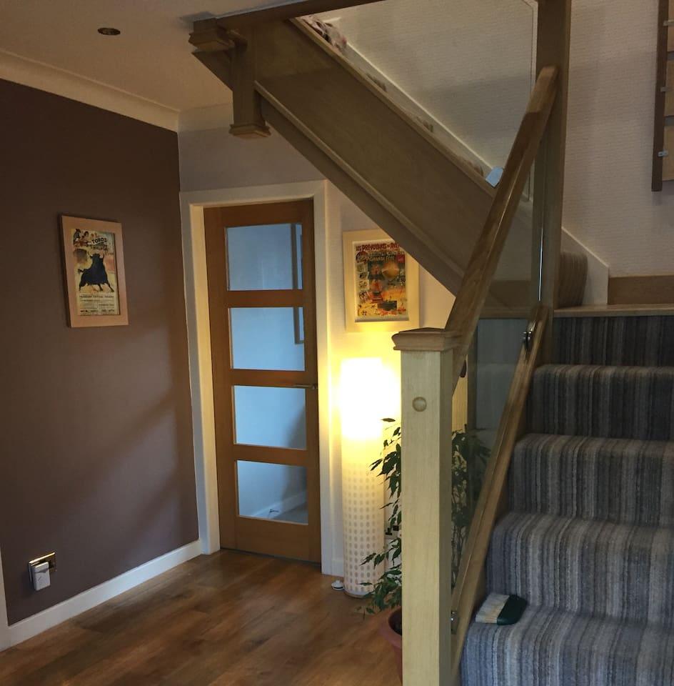 Hallway leading to single room.