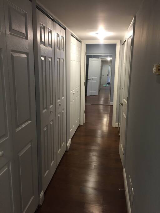 hall way with a lot of storage spaces