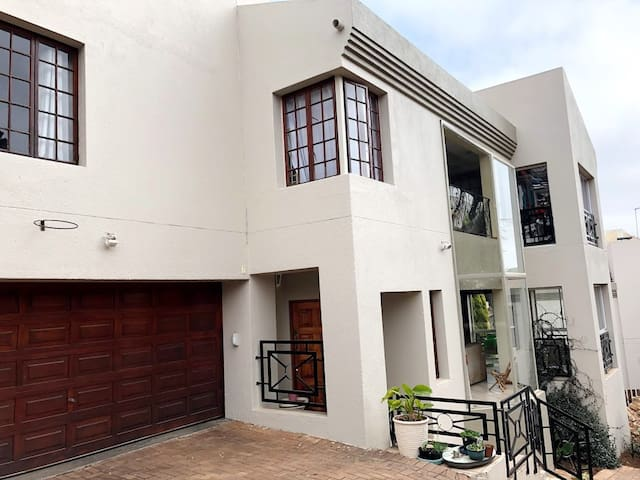 Modern spacious 5 bedroom house in a secure area